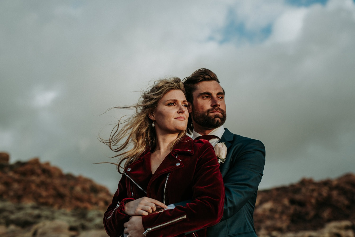 Eclectic hipster couple on their wedding day near Byron Bay. Bride wearing red velvet jacket.