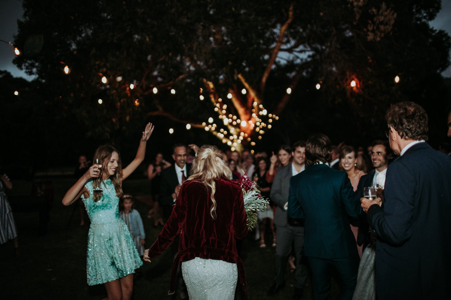 Couple entering their Byron Bay Outdoor Wedding Reception