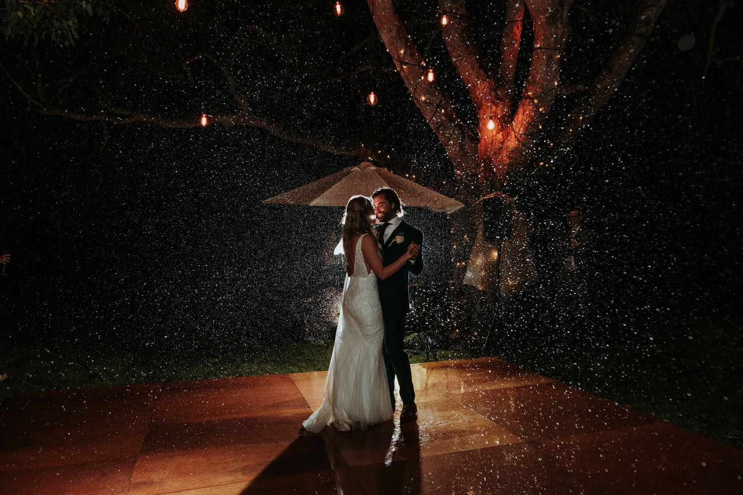 Couple during their first dance in the rain near Byron Bay