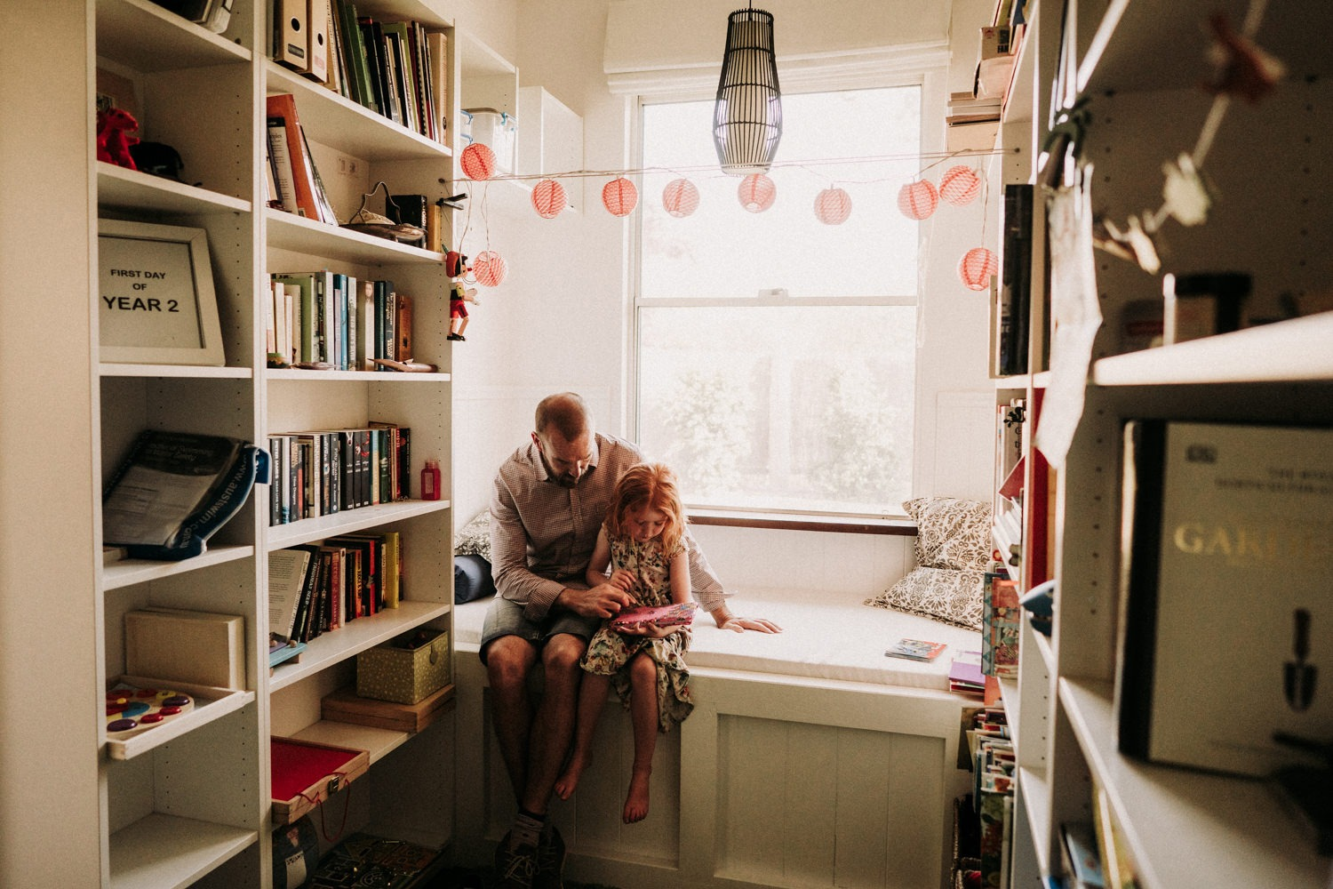 Father and daughter reading together in their Byron Bay home