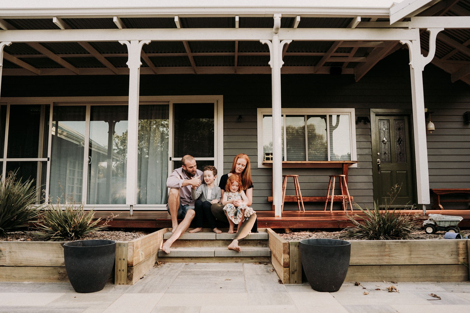 Family portrait on the veranda of their home in Byron bay