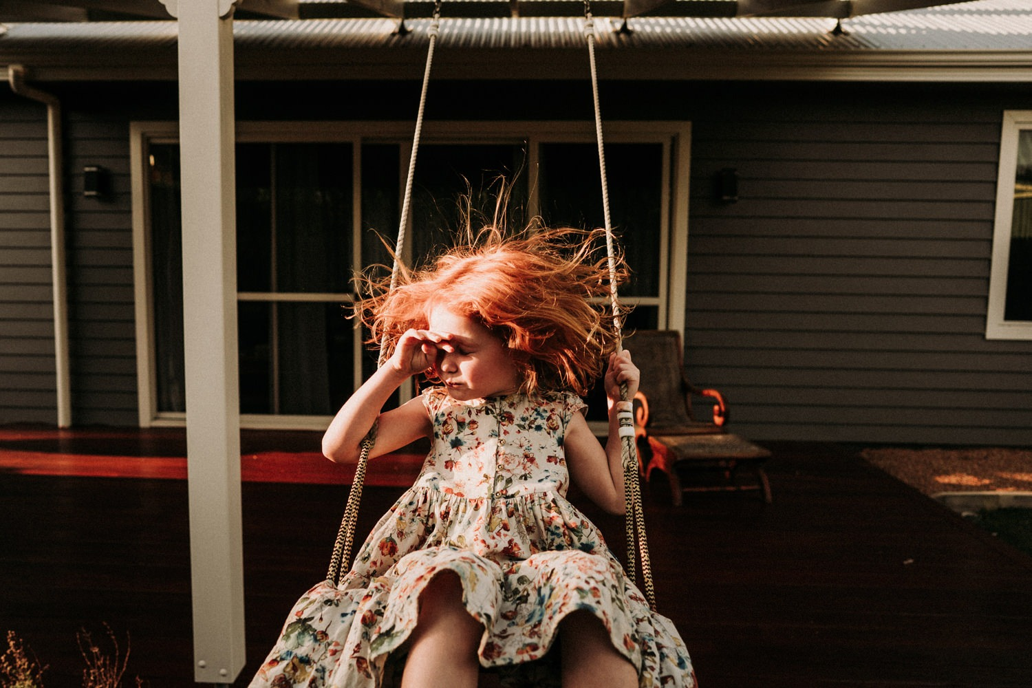 Young girl on her swing in Byron Bay