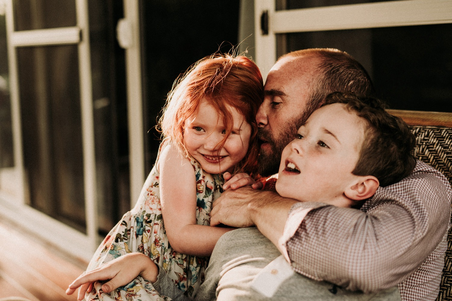 Family cuddles together during family photo session in Byron Bay